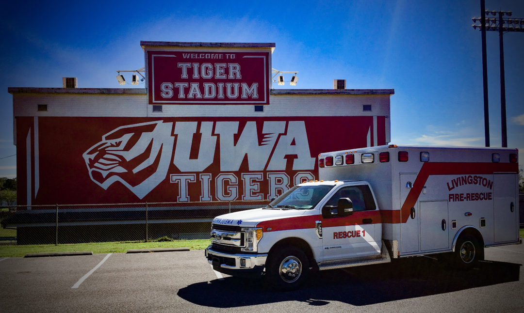 recently remounted ambulance in front of stadium it was used at